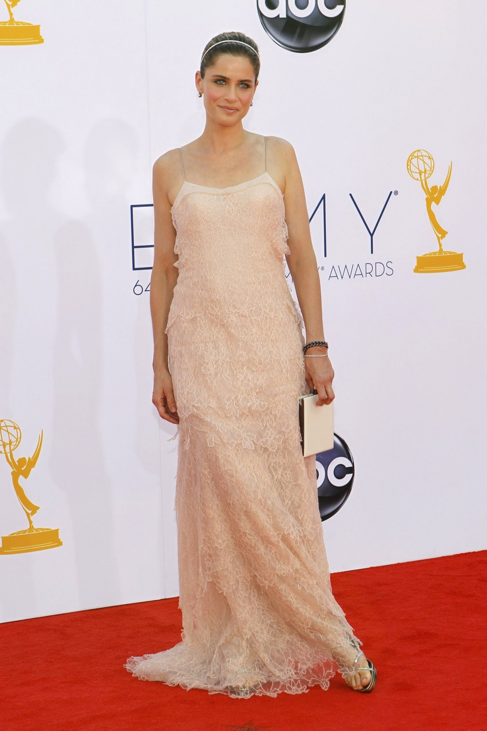 Actress Amanda Peet arrives at the 64th Primetime Emmy Awards in Los Angeles