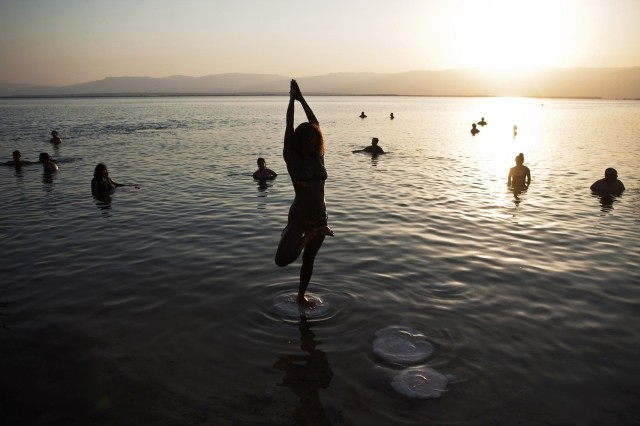 Woman practices yoga during a mass floating event in the Dead Sea. Yoga is a universal phenomenon and not a religious practice, claims Indian yoga gurus. (Photo: Reuters)