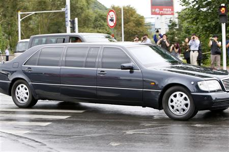 A vehicle that is believed to be carrying North Korean leader Kim Jong-il leaves the Wusong hotel in Jilin city