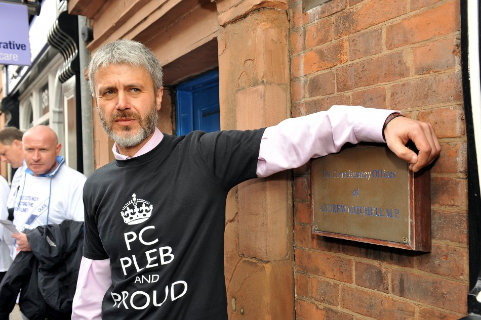 Payne poses in 'Pleb' t-shirt at Mitchell's office