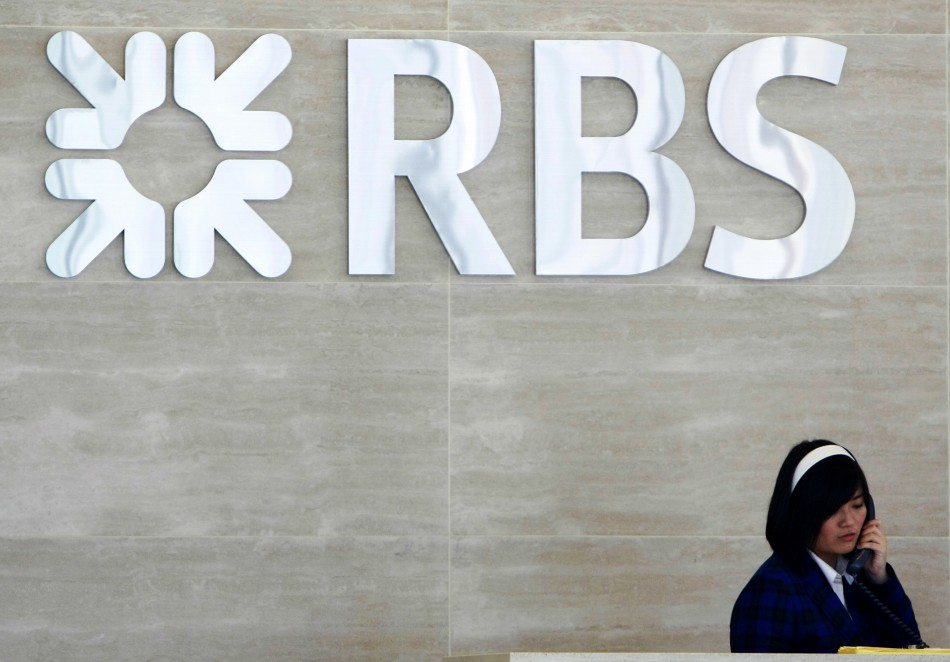 Receptionist speaks on phone at lobby of RBS office in Singapore (Photo: Reuters)