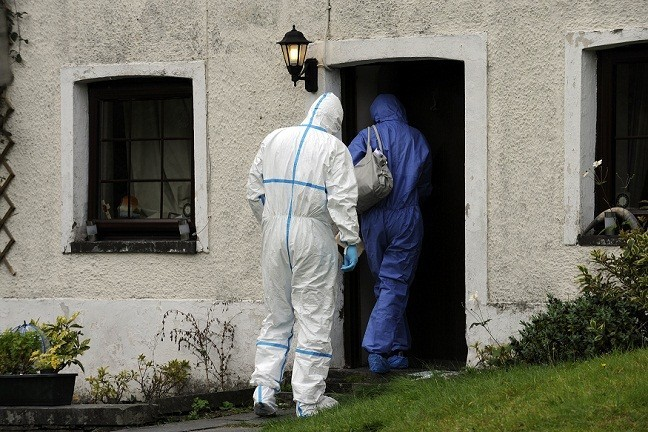 Police forensic officers enter Mark Bridger's house (Reuters)