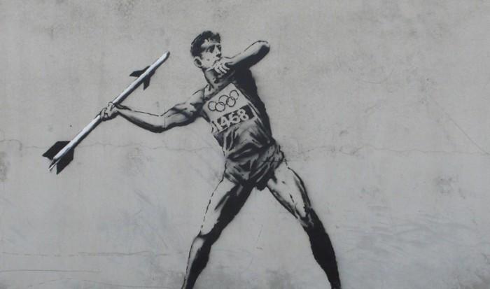 Street artist Banksy's commentary on the London Olympics 2012 (Photo: VNA)