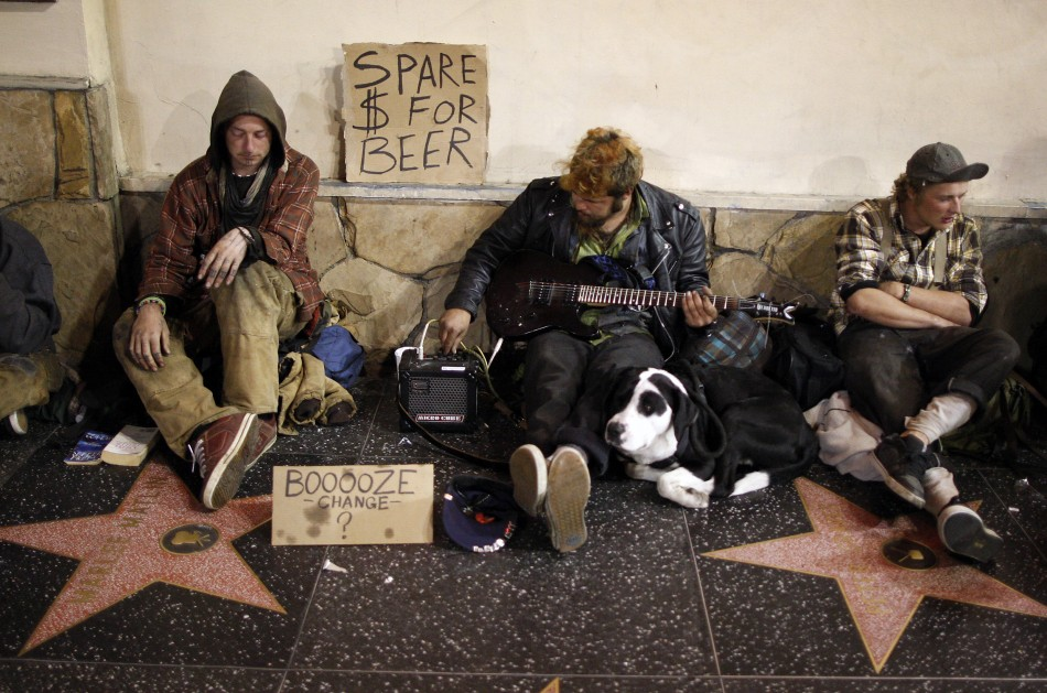 Homeless men sitting on Hollywood Walk of Fame stars on Hollywood Boulevard beg for money to buy beer in Hollywood (Photo: Reuters)