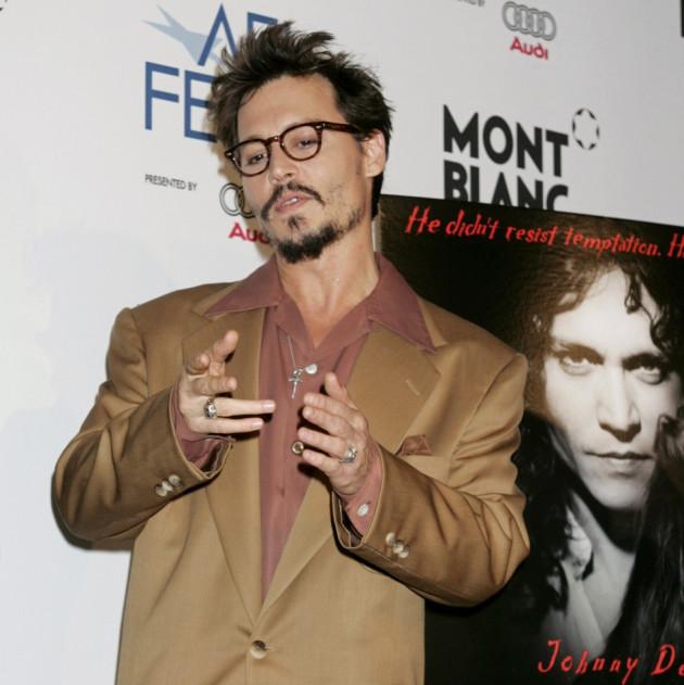 Actor Johnny Depp gestures at premiere of