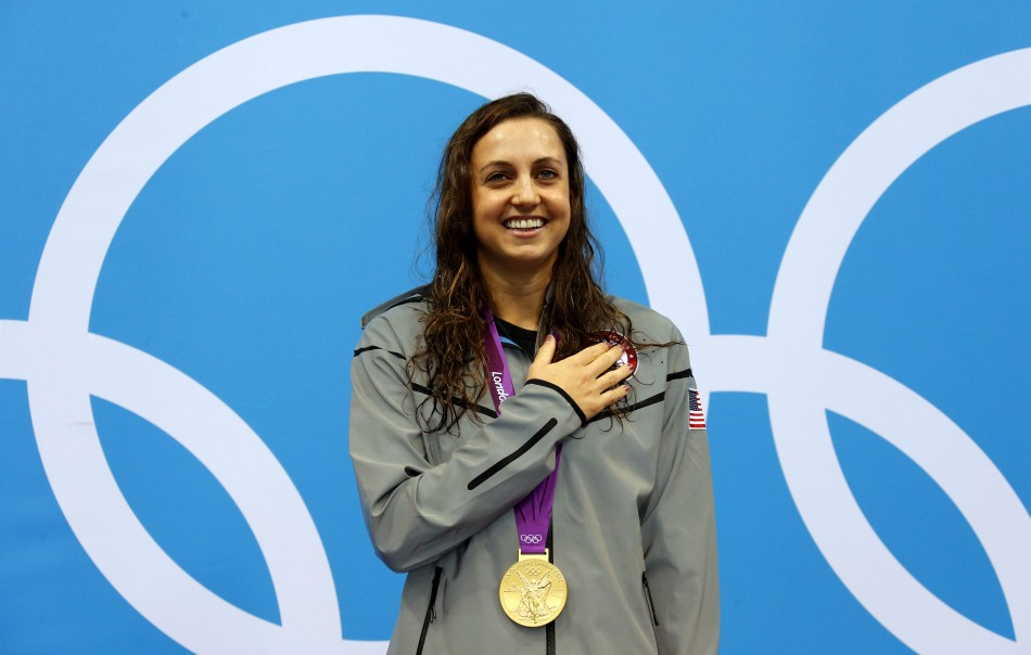 Rebecca Soni of the US smiles with her gold medal during the women's 200m breaststroke victory ceremony in the London 2012 Olympic Games at the Aquatics Centre (Photo: Reuters)