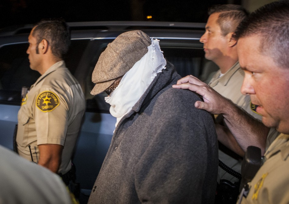 Mark Basseley Yousseff, aka Nakoula Basseley Nakoula is escorted out of him home in California (Reuters)