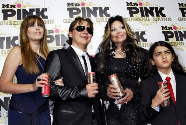 Paris, Prince and Blanket, children of the late Michael Jackson, pose next to their aunt La Toya Jackson at the Mr. Pink Ginseng Drink launch party in Beverly Hills