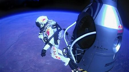 Felix Baumgartner of Austria jumps out of the capsule during the final manned flight for Red Bull Stratos in Roswell, New Mexico