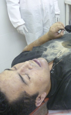 Body of Lazcano is seen lying on table after he was killed in a shootout with Marines in a gun battle in northern Mexico