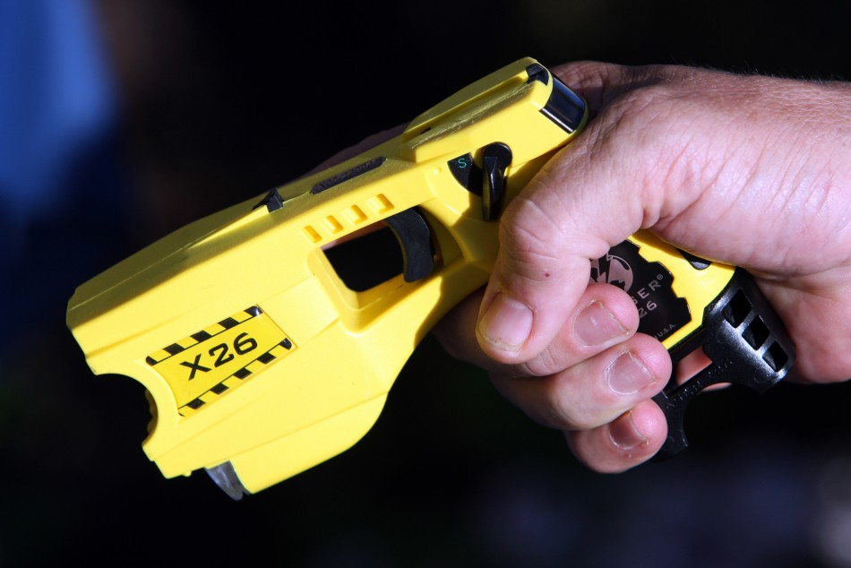 Taser guns deliver 50,000 volts of electricity into the body through two 21 feet electric wires. (