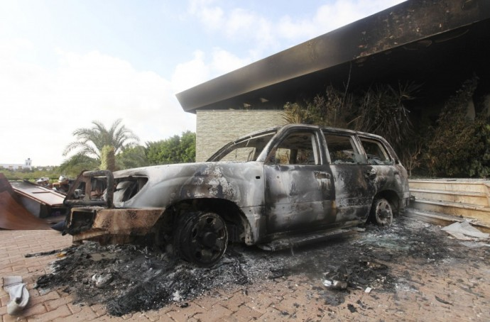 A burnt car is parked at the U.S. consulate, which was attacked and set on fire by gunmen yesterday, in Benghazi