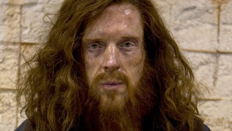 Damien Lewis's character after years in captivity
