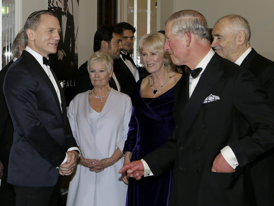Britain's Prince Charles and Camilla, Duchess of Cornwall meet actors Daniel Craig and Judi Dench as they arrive for the royal world premiere of the new 007 film