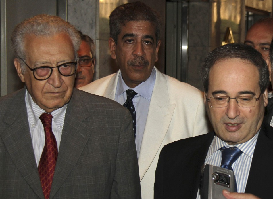 Syria's Deputy Foreign Minister Faisal Mekdad (R) speaks to reporters next to U.N.-Arab League peace envoy for Syria Lakhdar Brahimi (L)