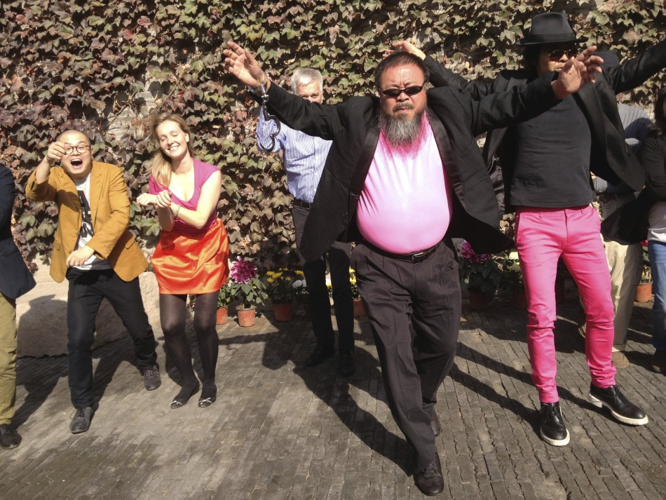Handout photo of dissident Chinese artist Ai Weiwei dancing