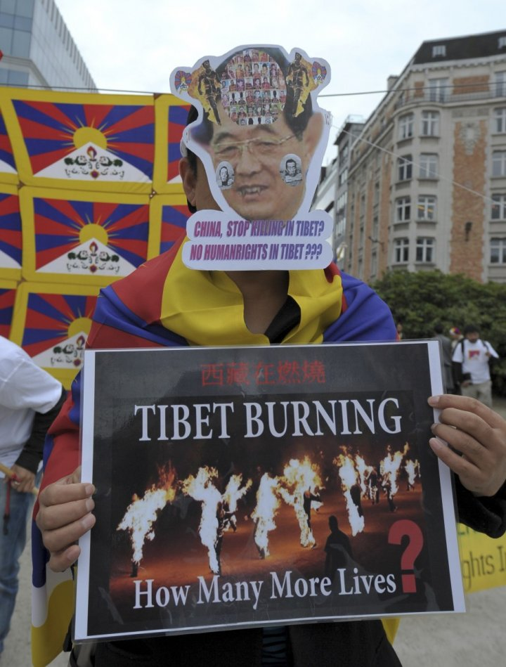 Tibet pro-independence activists demonstrate during a protest in Brussels
