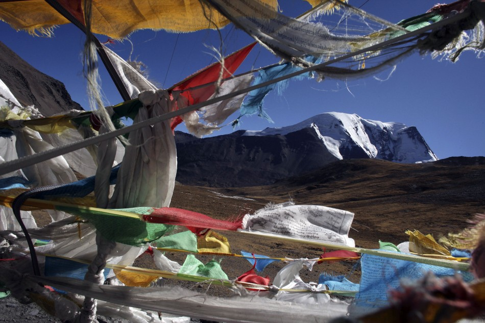 The Kharola glacier is seen through Tibetan praying flags