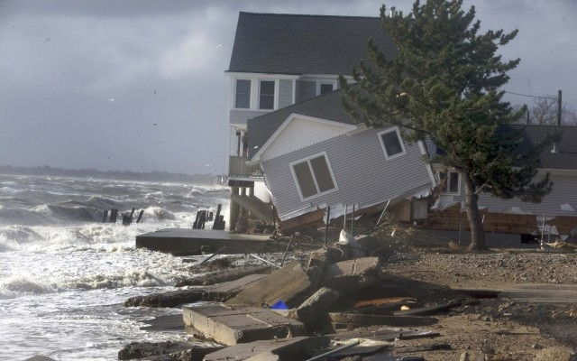 A home sits along the shoreline badly damaged by Hurricane Sandy in Milford, Connecticut. Human bones were discovered in New Haven as Sandy uprooted a tree. (Photo: REUTERS)