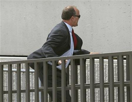 Former UBS banker Bradley Birkenfeld runs into the Federal Courthouse in Ft Lauderdale