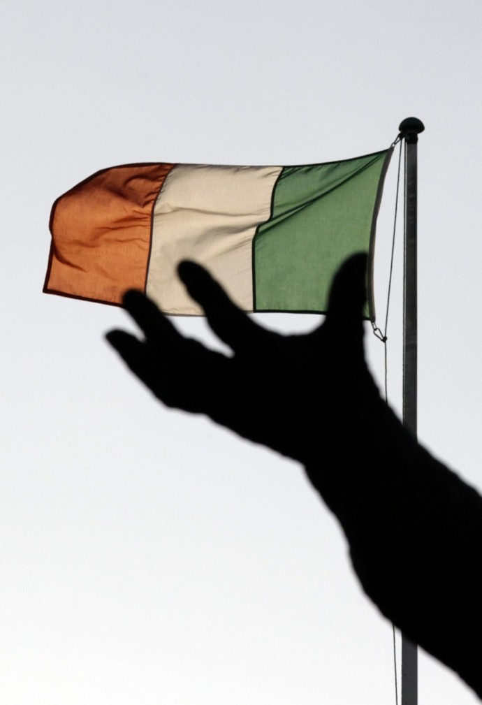 Ireland's national flag flies above a statue on O'Connell Street in Dublin December 5, 2011.