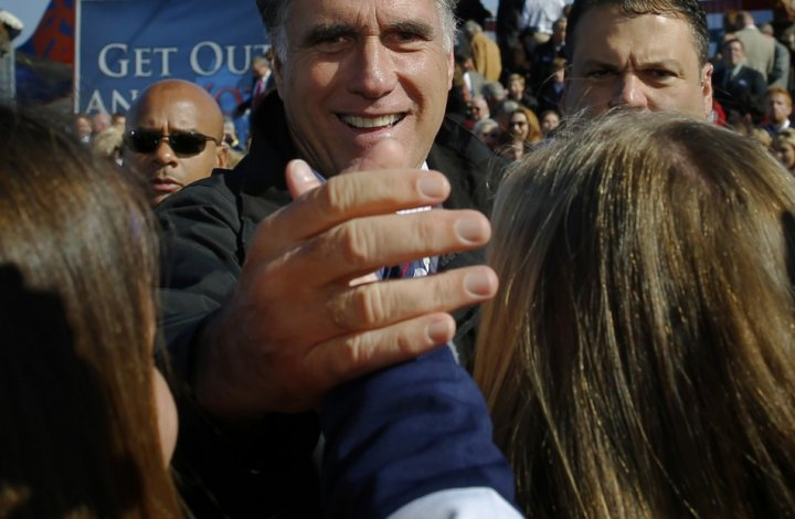 Republican presidential nominee Romney greets audience members at a campaign rally