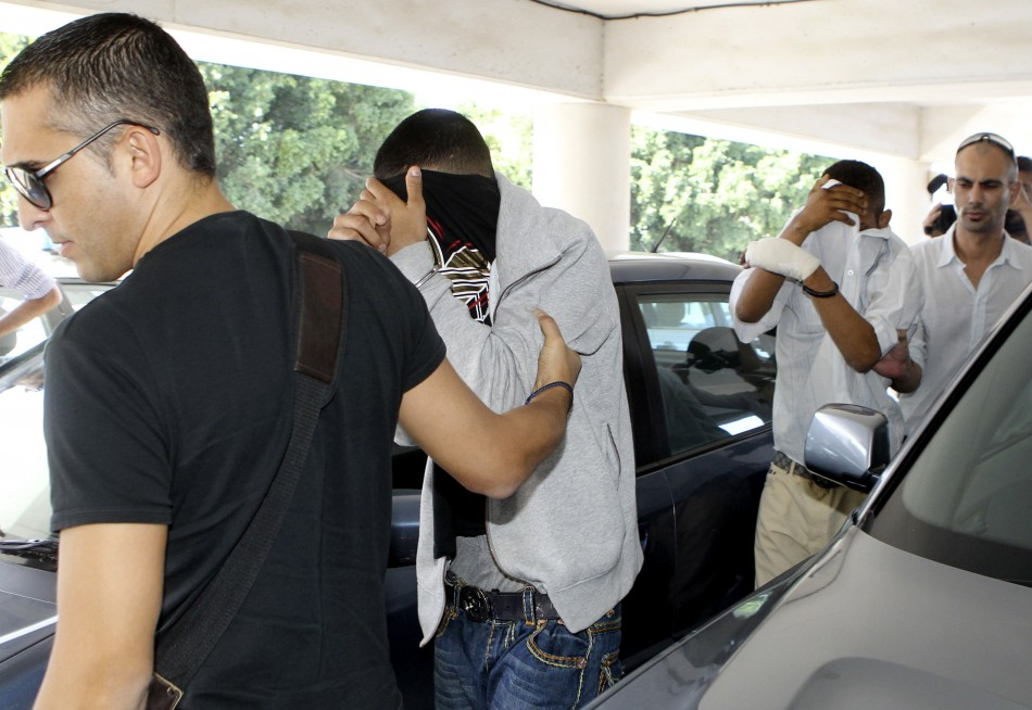 Police in Cyprus with two of the suspects
