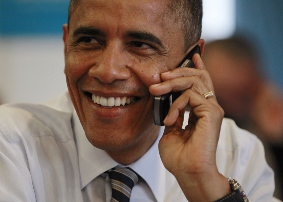 U.S. President Barack Obama makes a phone call to a volunteer for his campaign