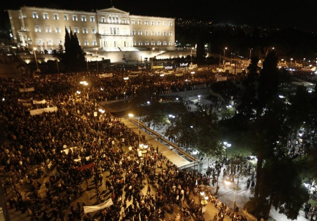 Protestors gather in front of the parliament in Syntagma square in central Athens during a 48-hour strike by the two major Greek workers unions (Reuters)