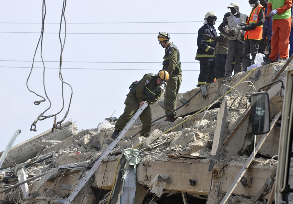 Members of an Israeli military team search for survivors among the debris of a collapsed shopping mall in Accra (Reuters)