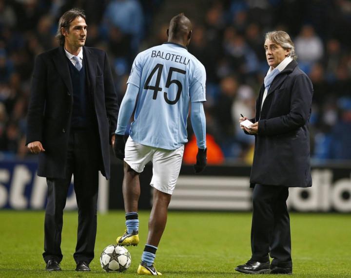 Roberto Mancini (R) and Mario Balotelli