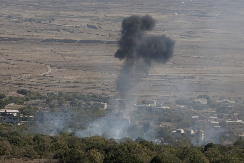 Smoke rises after shells exploded in the Syrian village of Bariqa, close to the ceasefire line between Israel and Syria,