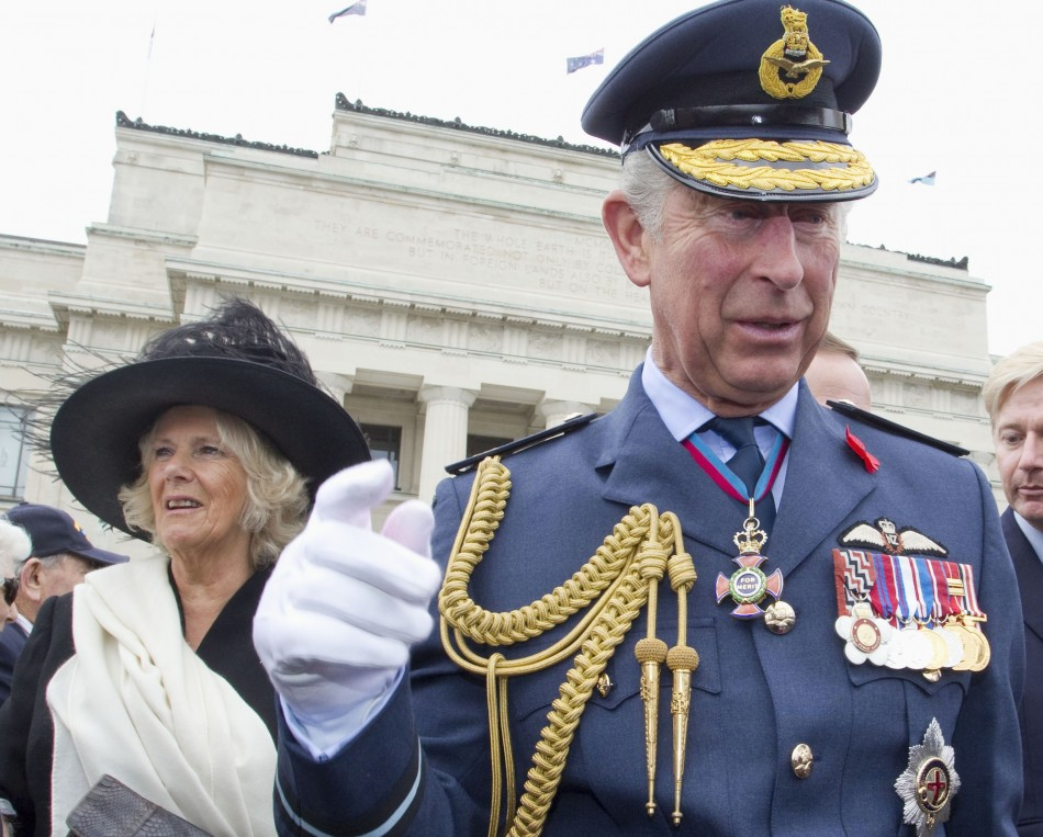 Britain's Prince Charles waves alongside his wife Camilla, Duchess of Cornwall as they attend the Armistice Day Commemoration at the Auckland War Memorial Museum