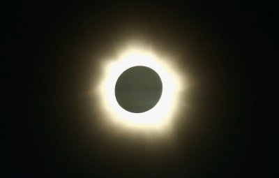 The moon passes in front of the sun during a full solar eclipse at Palm Grove near the northern Australian city of Cairns