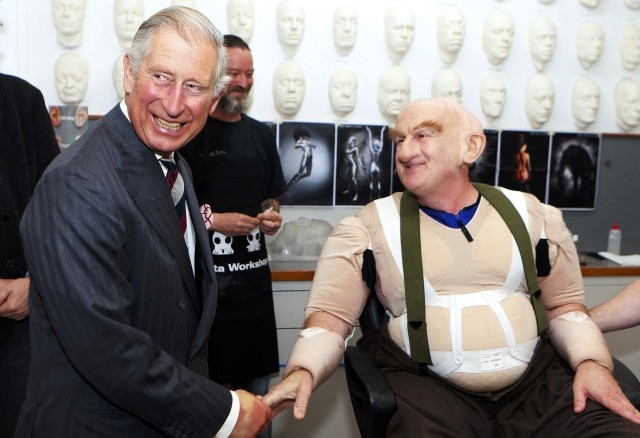 Britain's Prince Charles meets actor Peter Hambleton, who is dressed as Gloin the dwarf in The Hobbit movies, during a visit to the makeup department of film maker Peter Jackson's Weta Workshop in Wellington on his 64th birthday, November 14, 2012.