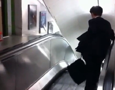 Wrong way: Commuter on escalator