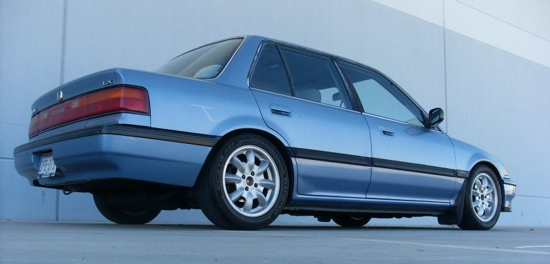 Would you laugh at a car like this? A blue Sedan