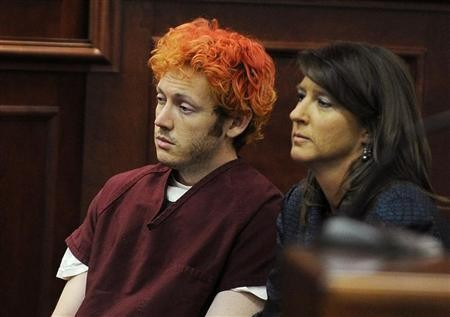 Colorado shooting suspect James Holmes (L) sits with public defender Tamara Brady during his first court appearance (Reuters)
