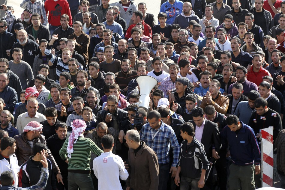 Anti-government protesters shout slogans during a demonstration