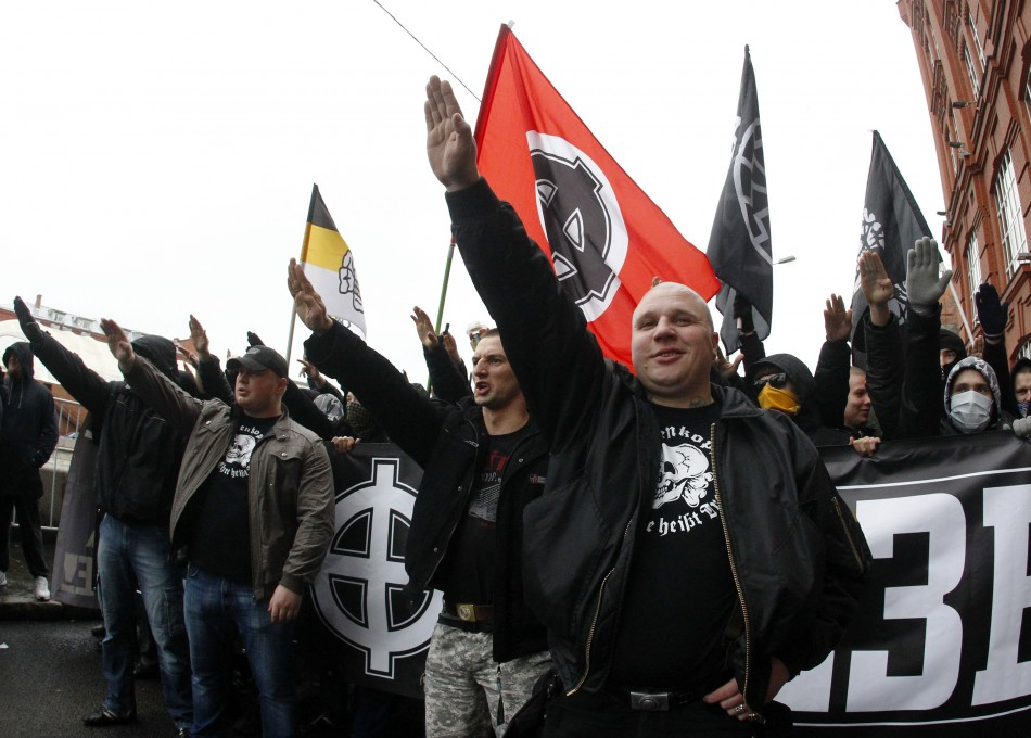 """Russian nationalists shout as they attend a """"Russian March"""" demonstration on National Unity Day in Moscow"""
