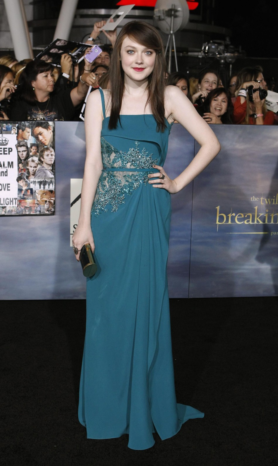 Cast member Dakota Fanning poses at the premiere of The Twilight Saga Breaking Dawn - Part 2 in Los Angeles