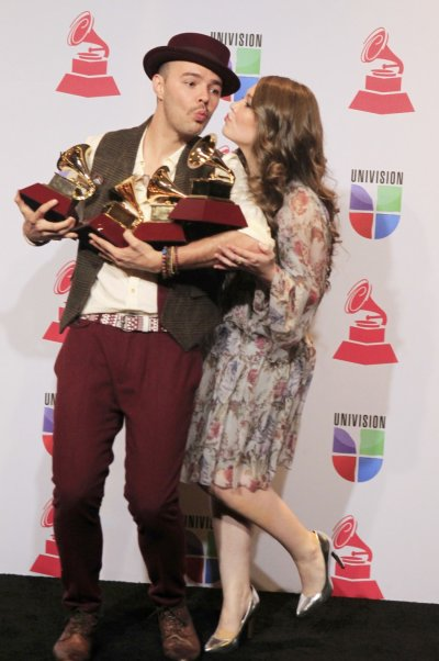 Jesse  Joy pose with their four awards during the 13th Latin Grammy Awards in Las Vegas