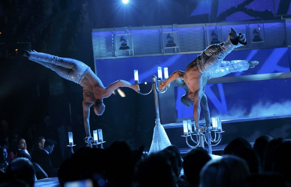 Dancers from LeReve perform with Jesse  Joy at the 13th Latin Grammy Awards in Las Vegas