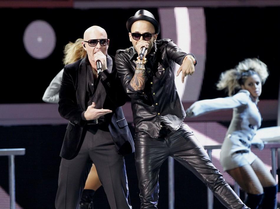 Pitbull and Sensato perform during the 13th Latin Grammy Awards in Las Vegas