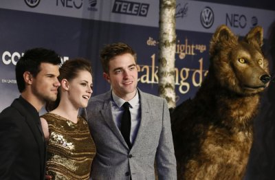 Pattinson, Stewart and Lautner pose for pictures before premiere of The Twilight Saga Breaking Dawn Part 2 in Berlin
