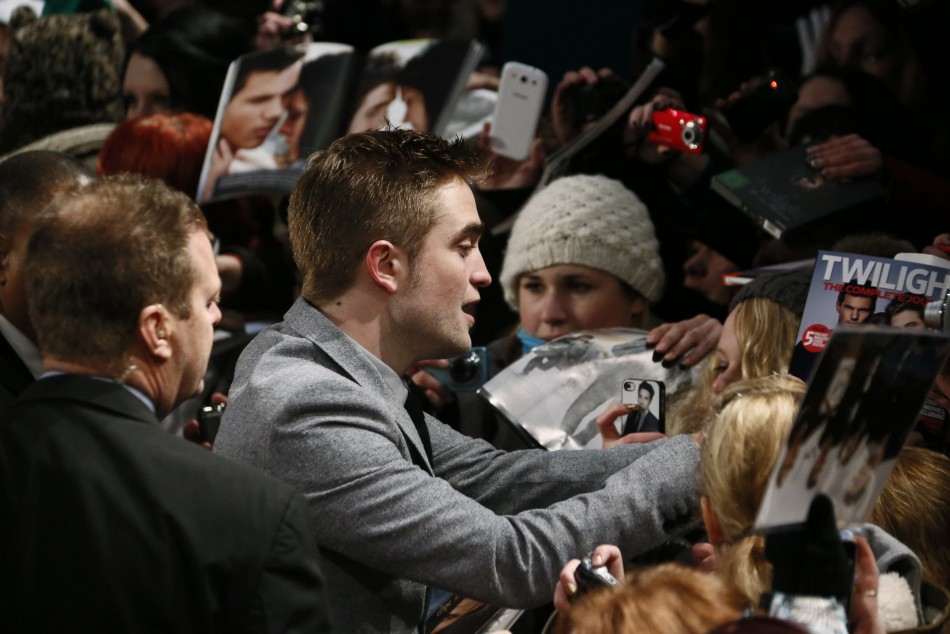 Cast member Pattinson signs autographs before German premiere of The Twilight Saga: Breaking Dawn Part 2 in Berlin