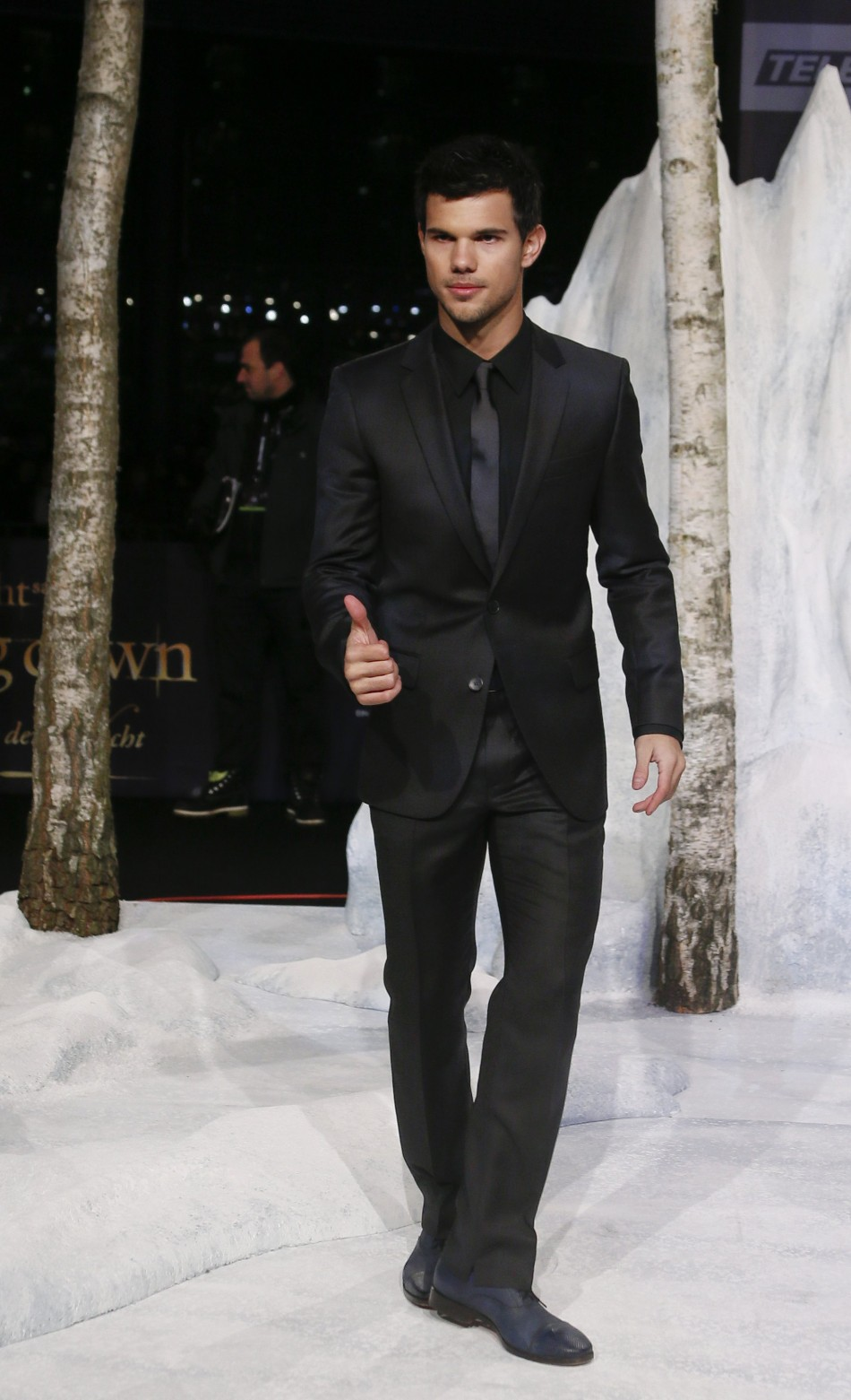 Lautner poses for pictures before German premiere of The Twilight Saga: Breaking Dawn Part 2 in Berlin