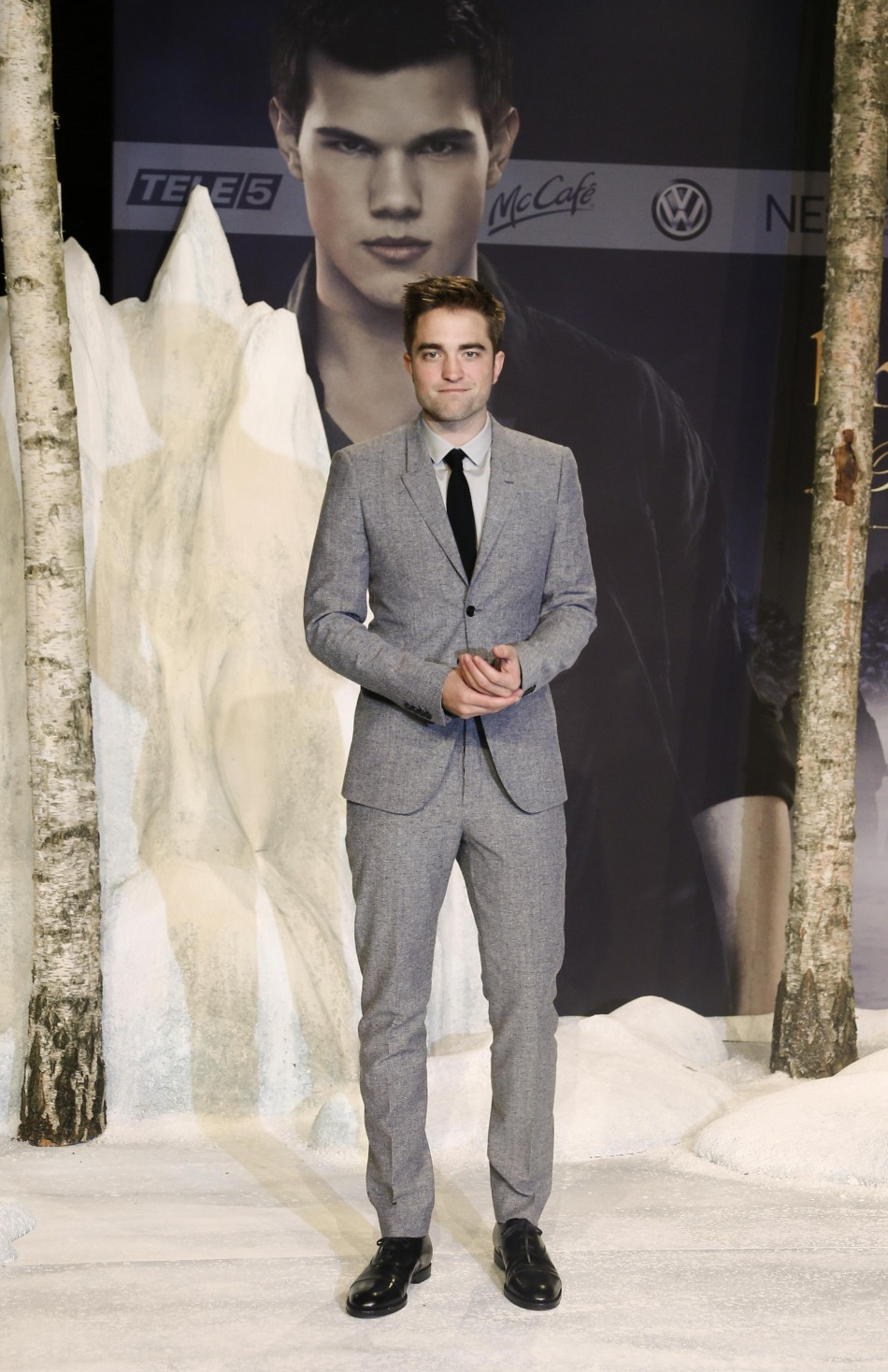 Pattinson poses for pictures before German premiere of The Twilight Saga Breaking Dawn Part 2 in Berlin