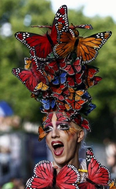 Participant wearing a costume featuring butterflies takes part in the Gay Pride parade in Buenos Aires, 10 November. The 2012 Rio de Janeiro LGBT pride parade takes place on 18 November. (Photo: REUTERS)