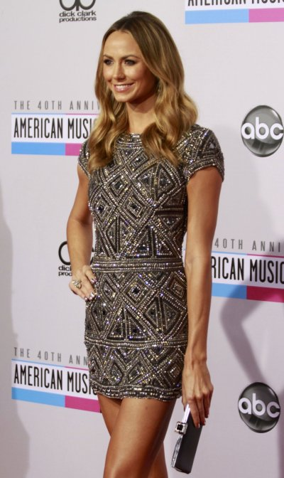 Television personality and former wrestler Stacy Kiebler arrives at the 40th American Music Awards in Los Angeles